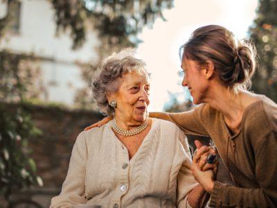 Canva-Joyful-adult-daughter-greeting-happy-surprised-senior-mother-in-garden-1