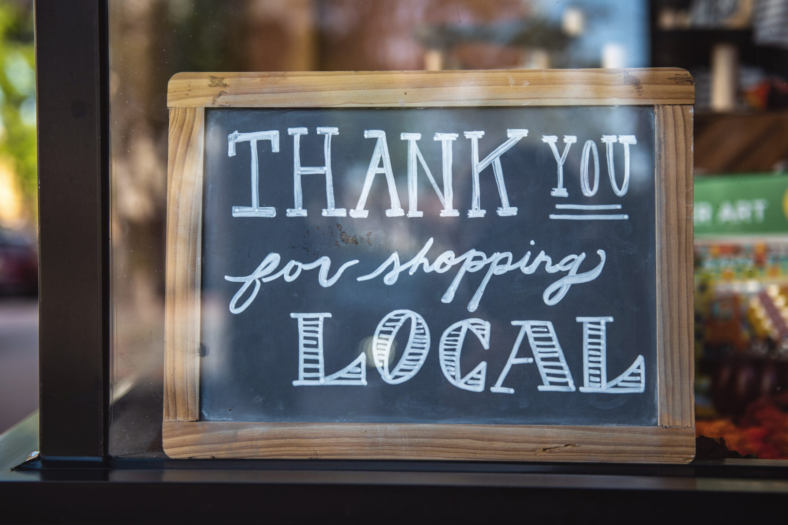 Thank you for shopping local small business sign in window